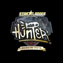Наклейка | huNter- (золотая) | Берлин 2019